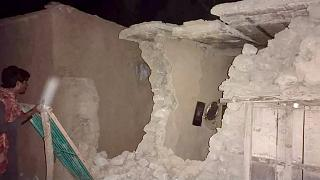 A local resident looks his damaged house following a severe earthquake hit the area, in Harnai, about 100 kilometre from Quetta, Pakistan, Thursday, Pakistan