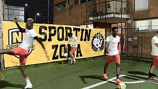 Refugees at the St. Ambroeus football club in Milan.