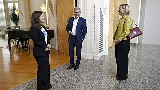 Finnish 16-year-old Nella Salminen (L), President Sauli Niinisto (C) and MP Eva Biaudet stand at the Presidential Residence Mantyniemi in Helsinki, Finland, on October 6, 2021
