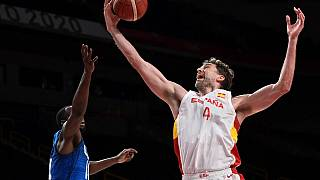 Spain's Pau Gasol (R) fights for the rebound with USA's Draymond Jamal Green (L) in the men's quarter-final basketball match during the Tokyo 2020 Olympic Games.