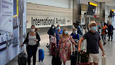 Passengers arriving into Heathrow Airport in London.
