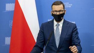 ماتيوس مورافيسكي، رئيس الوزراء البولندي خلال مؤتمر صحفي في فيلنيوس، ليتوانيا.