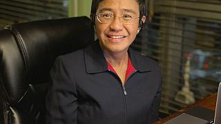 In this photo provided by the Rappler, Rappler CEO and Executive Editor Maria Ressa smiles at her home after being awarded the Nobel Peace Prize