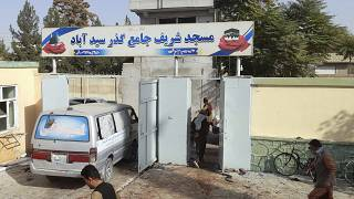 Blood stains the compound outside the mosque in Kunduz province.