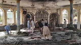 People view the damage inside of a mosque following a bombing in Kunduz, province northern Afghanistan