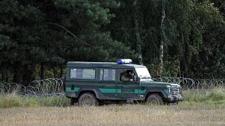 Polish border guards monitor an area along the border with Belarus in Usnarz Gorny.
