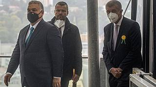 Czech Prime Minister Andrej Babis (R) and his Hungarian counterpart Viktor Orban (L) leave a cabin lift as they arrive for lunch at the Vetruse restaurant in Usti nad Labem.