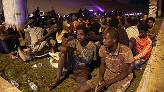 Migrants recaptured by Libyan security forces following an escape attempt from a detention centre in the capital Tripoli, October 8, 2021. Guards shot six migrants dead.