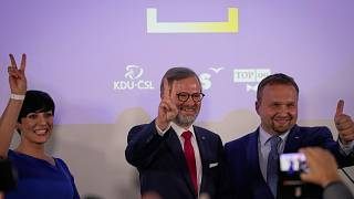 Leader of Spolu (Together) Petr Fiala, centre, at the party's headquarters after the country's parliamentary election, Prague, Czech Republic, Oct. 9, 2021.
