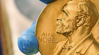 A April 17, 2015 file photo shows a gold Nobel Prize medal. The Nobel Prize for Economics will be announced on Monday Oct. 11, 2021.