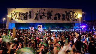 جانب من احتفالات أنصار التيار الصدري في ساحة التحرير في بغداد، 11 أكتوبر 2021