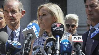 In this file photo from 2019, Virginia Giuffre, who says she was trafficked by sex offender Jeffrey Epstein, holds a news conference outside a Manhattan court in New York.