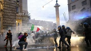 Demonstrators and police clash during a protest, in Rome, Saturday, Oct. 9, 2021.
