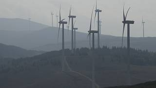 Wind turbines stand out at a wind farm in Collarmele, near L'Aquila, Thursday, Sept. 30, 2021.
