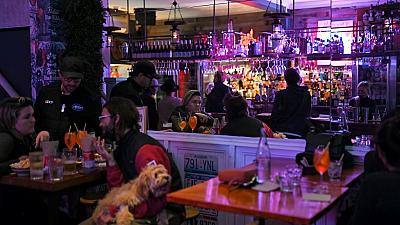 Patrons eat and drink inside a bar in Sydney on October 11, 2021, as Sydney ended their lockdown against the Covid-19 coronavirus after 106 days.