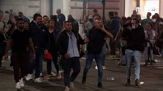 """Forza Nuova leader Giuliano Castellino (C) shout during clashes after a protest against the compulsory """"green pass"""" to limit the spread of COVID-19, Rome, October 9, 2021."""