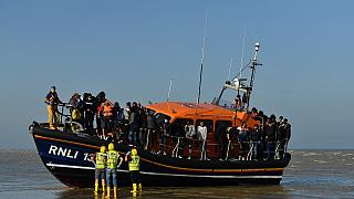 Migrants stand aboard an RNLI (Royal National Lifeboat Institution) lifeboat after being rescued crossing the English channel at Dungeness, England, September 7, 2021.