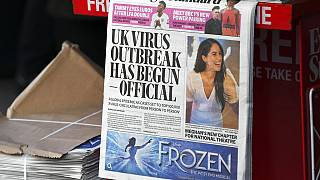In this Friday, March 6, 2020 file photo, the front page of the Evening Standard is displayed at Bond Street Station, in London.