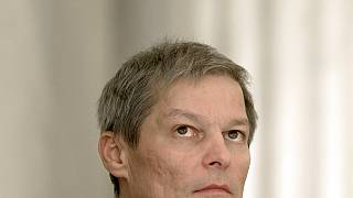 Romania's prime minister Dacian Ciolos looks up during the swearing-in ceremony of the new government in Bucharest, Romania, Tuesday, Nov. 17, 2015