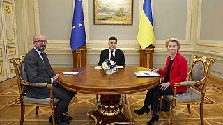 Ukrainian President Volodymyr Zelenskyy, center, European Commission President Ursula von der Leyen, right, and European Council President Charles Michel