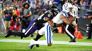 Indianapolis Colts wide receiver Michael Pittman (11) leans for a touchdown with Baltimore Ravens cornerback Marlon Humphrey (44) on his back
