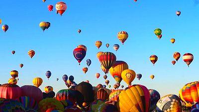 Hundreds of balloons take flight during the Albuquerque International Balloon Fiesta