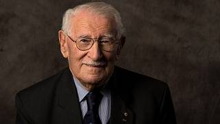 In this undated photo provided by the Sydney Jewish Museum, Holocaust survivor Eddie Jaku poses for a photograph in Sydney, Australia