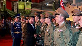 Kim reviews powerful missiles at weapon convention