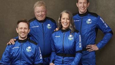 This undated photo made available by Blue Origin in October 2021 shows, from left, Chris Boshuizen, William Shatner, Audrey Powers and Glen de Vries.