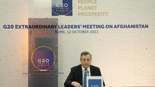 Italian Premier Mario Draghi during a press conference at the end of a virtual summit of the Group of 20 dedicated to Afghanistan in Rome, Tuesday, Oct. 12, 2021.