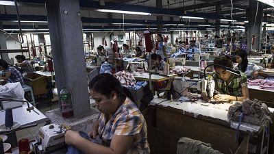Seamstresses work at a garment factory in Yangon.