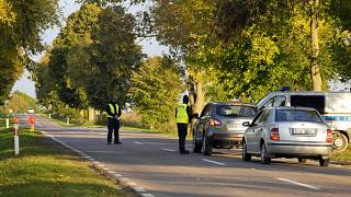 Polish police officers stop vehicles near the Belarusian border.