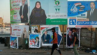 ملصقات  لمرشحين البرلمان العراقي في أحد شوارع بغداد، العراق.