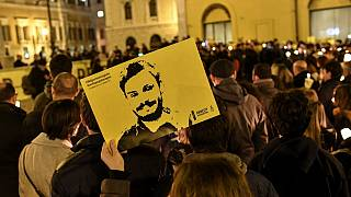 Amnesty International activists hold a picture of Giulio Regeni during a demonstration in front of the Italian Parliament in January 2017.
