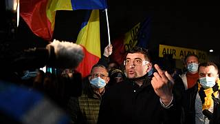 George Simion, the leader and parliament member of nationalist party AUR (The Alliance for the Unity of Romanians) gestures during a protest in Bucharest.
