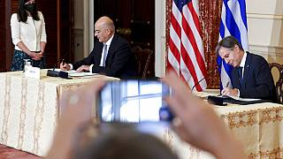 Secretary of State Antony Blinken and Greece's Foreign Minister Nikos Dendias sign the renewal of the U.S.-Greece Mutual Defense Cooperation Agreement at the State Department