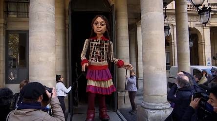 Giant puppet, of Syrian girl, visits sights of Paris