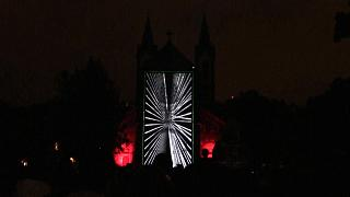 """Videomapping show called """"The Wind"""" projected on a Prague church."""