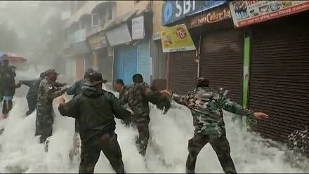 India: Building collapse and rescue operations after deadly floods.