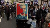 Supporters of WikiLeaks founder Julian Assange march to London's High Court