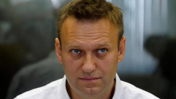 Russian opposition leader Navalny splashed with green liquid in Siberia