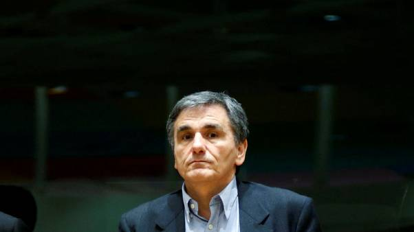 Greek finance minister to remain in Brussels to pursue a deal with lenders