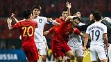 Yu header boosts China's slim World Cup hopes