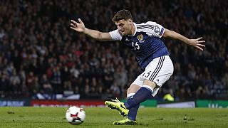 Scotland's hopes still alive after late Martin winner