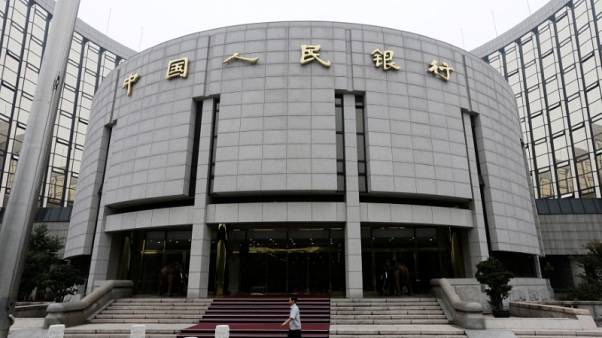China central bank has set no limits on yuan outflows - paper