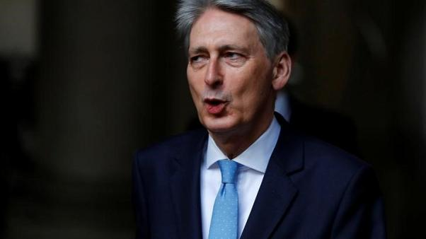 Hammond says 2015 tax promises hamper government