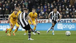 Four-goal Newcastle romp back to Premier League