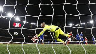 Arsenal boost Champions League hopes with late own goal