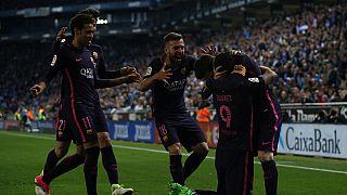 Suarez and Rakitic see Barca through Espanyol test to stay top