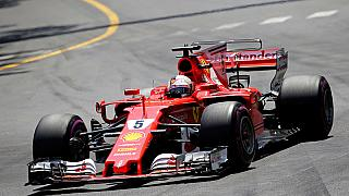 Vettel leads Ferrari party as Raikkonen chafes